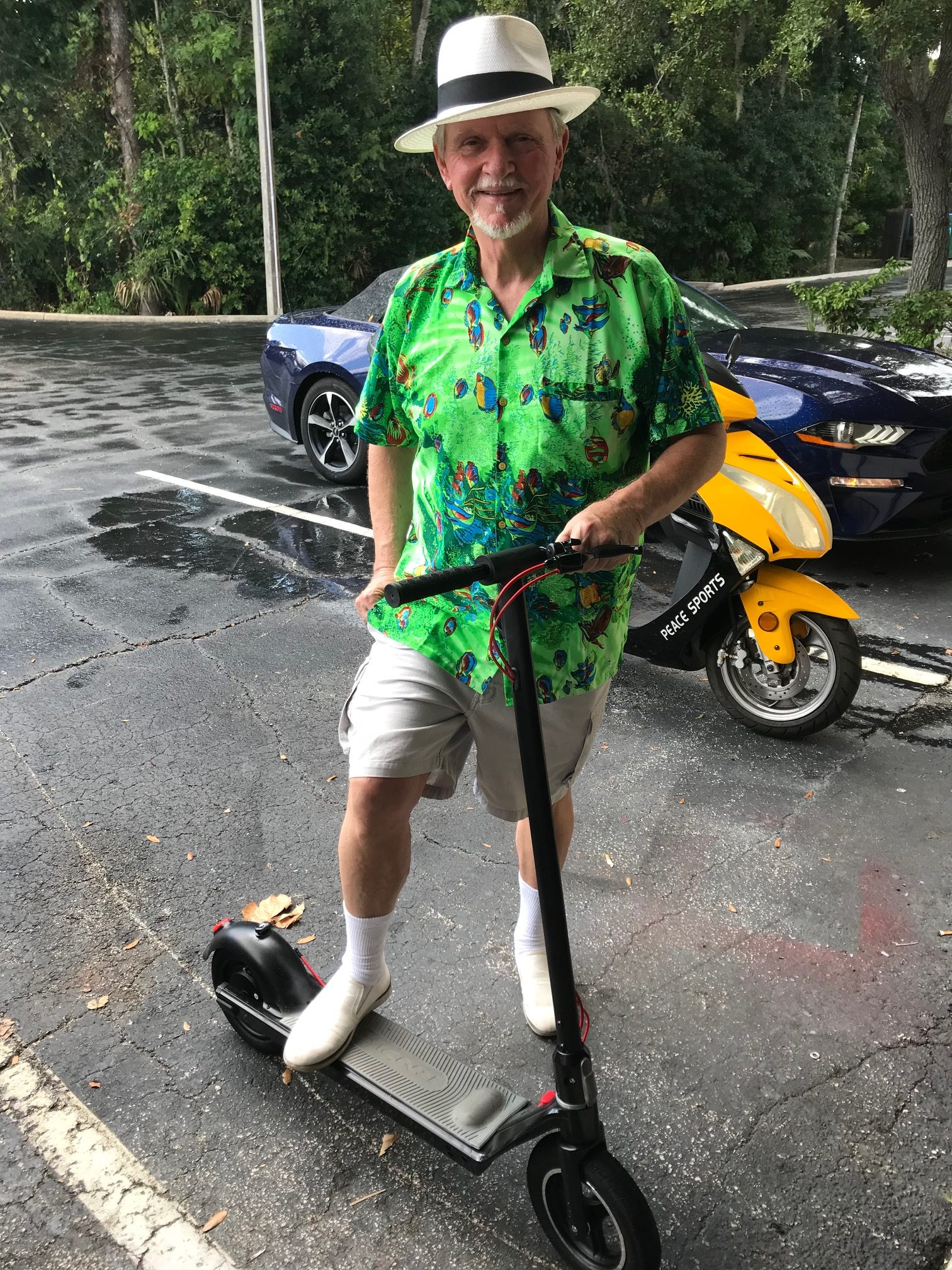 Dad e-scooter pose